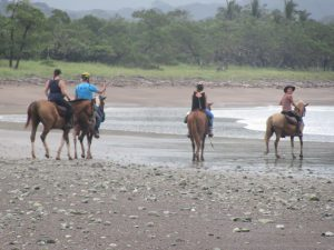 Horseback riding at the beach in Sámara with Costa Rica trips
